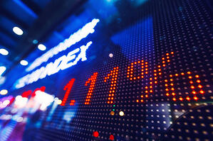 Stock price in neon lights on index board.